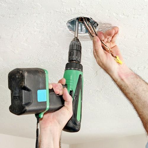 electrician fixing ceiling fan